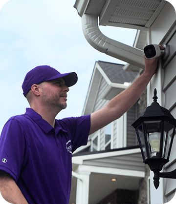 Guardian Protection installation expert installing outdoor camera